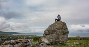 student-photographing-on-rock